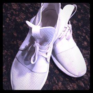 Adidas tubular sneakers.